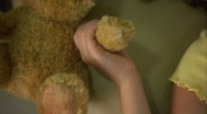 Girl's hand releases her teddy bear. Stock Footage