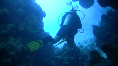 Diver Exits Underwater CAVE Stock Footage