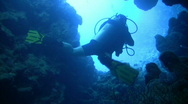 Stock Video Footage of Diver Exits Underwater CAVE