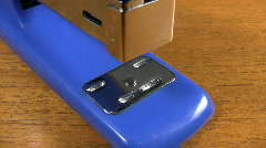 Office stapler. Stapling papers together. Stock Footage