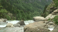 Hiker beside a mountain stream Stock Footage