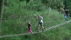 Man and children walk on a bridge 1 Stock Footage
