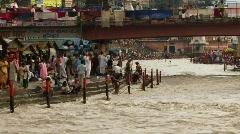 Crowds of Hindu pilgrims on Ganges Stock Footage