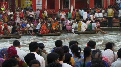 Indian crown worship on Ganges river Stock Footage