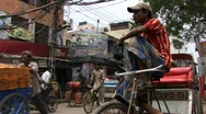 Stock Video Footage of Indian man sat on bicycle rickshaw old Delhi (w/sound)