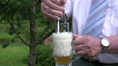 Pouring beer into a stein 1  Stock Footage