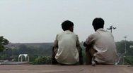 Stock Video Footage of Indian men sat on steps of Mosque