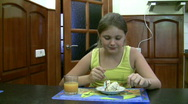 Girl for dessert eats a pie. Stock Footage
