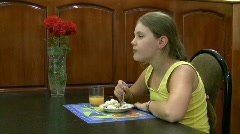 Girl for dessert eats a pie Stock Footage