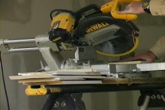 Sawing lumber with power saw Stock Footage