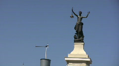 Lady Justice and windmill  Stock Footage