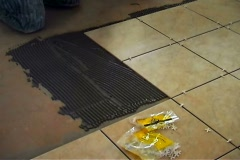 Laying floor tile Stock Footage