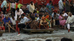 Huge Indian crowd on Ganges (w/sound) Stock Footage