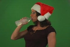 Brunette with Santa Hat and Bottled Water Stock Footage