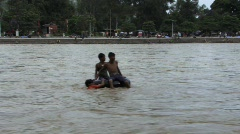 Indian boys playing in Ganges river (w/sound) Stock Footage