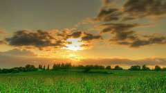 HDR time lapse of sunset over fields Stock Footage