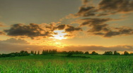 Stock Video Footage of HDR time lapse of sunset over fields