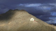 Time lapse clouds over Buddhist monastery Stock Footage