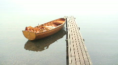Rowing boat at landing stage Stock Footage