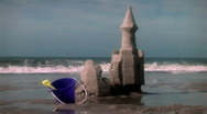 Stock Video Footage of Beach Sandcastle Falls Down with Tide