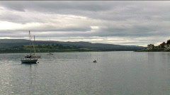 Lone Canoeist Paddles Up Firth of Clyde Scotland Stock Footage