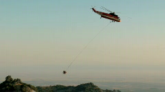 Helicopter transporting a cement bucket part 2 Stock Footage