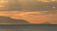 Stock Video Footage of Sunset With Arran In Distance Zoom Out