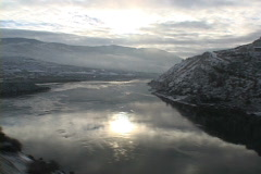 Winter N Thompson River from train 2 Stock Footage