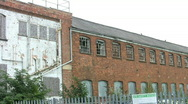 Broken windows of a closed and derelict factory building. Stock Footage