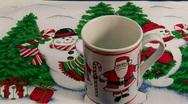 Serving hot chocolate in Christmas Santa mug Stock Footage