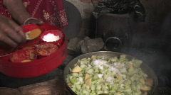 Nepal: Woman cooks - stock footage