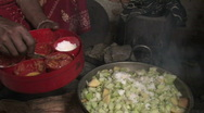 Stock Video Footage of Nepal: Woman cooks Stock Footage