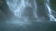 Waterfall at Milford Sound in New Zealand Stock Footage