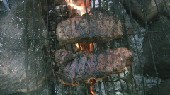 Campfire steaks w/ sizzling sound! Stock Footage