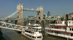 Pleasure boats below Tower Bridge over the River Thames in London  England UK - stock footage