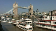 Stock Video Footage of Pleasure boats below Tower Bridge over the River Thames in London  England UK
