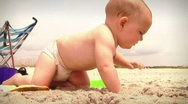 Stock Video Footage of Infant toddler baby at summer beach with family playing in sand