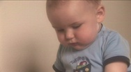 Stock Video Footage of Baby at Home Series - Drinking and Falling Over