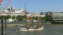 Thames sailing barge and a Clipper ferry on the River Thames in London  England Stock Footage