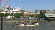Stock Video Footage of Thames sailing barge and a Clipper ferry on the River Thames in London  England