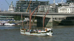 Thames sailing barge turning before London Bridge over then River Thames. Stock Footage