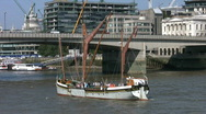 Stock Video Footage of Thames sailing barge turning before London Bridge over then River Thames.