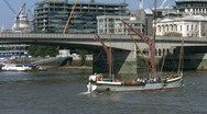Stock Video Footage of Thames sailing barge with London Bridge in the background.  London England UK