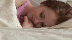 Woman Lying on Bed Stock Footage