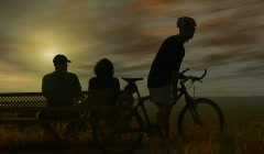 Sunset View Couple and Mountain Biker Stock Footage