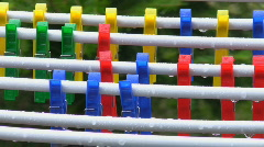 Multi-coloured clothespins under a rain Stock Footage