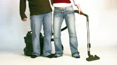 couple with vacuum cleaner 2 - stock footage