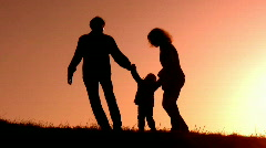 Family with little girl sunset silhouette Stock Footage