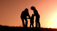 Stock Video Footage of Family with little girl sunset silhouette
