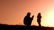 Father with children play ladushki Stock Footage
